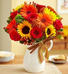 Add some flair to all your Fall celebrations with our vibrant bouquet of richly colored roses, Gerbera daisies, sunflowers, hypericum and more.