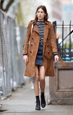 Spotted in New York City, Alexa Chung in a suede belted trench coat from the Gucci Cruise 2016 collection by Alessandro Michele.