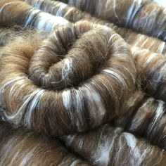 A personal favourite from my Etsy shop https://www.etsy.com/uk/listing/467677382/60g-carded-alpaca-and-silk-rolags-for