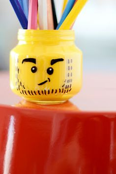 I LOVE THIS! A lego head pencil holder made from a baby food jar!