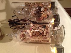 Apothecary Jars filled with neutrals and wine corks on mantle. #glass