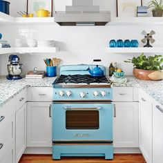 Inspiration for this Sullivan's Island, South Carolina, cottage all started with a shiny turquoise-and-white fridge and a dreamy blue range. | Coastalliving.com