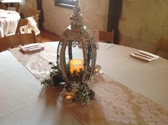 Shabby Chic Ivory Globe Lantern provided and Styled by BundleBride in Conroe Texas