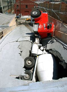 Cement truck falls thru parking garage ramp   www.crcint.com