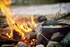 Warm fire...outside...at a camp site...in the great outdoors...tranquility