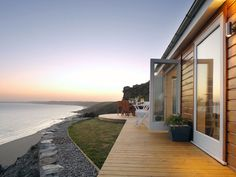 For those hoping to spend their days lounging on the beach, a path leads directly from the hut's deck down to the surf. - CountryLiving.com