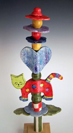 Garden totems by Prairie Dog Pottery put a bit of color in your garden. Part whimsy, part Dr. Suess, these handmade garden totems are easy to ship and can stay outside year round.