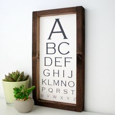 NOW HALF PRICE CLEARANCE - WAS £30.00 - NOW £15.00 A modern take on a traditional eye chart design. This beautiful hand painted sign is handmade by us in our workshop near London.  Black painted letters on a slightly distressed white painted board. The frame is stained and intentionally rustic.  Overall the sign measures 13 inches by 7 inches.  A unique Bobby Loves Rosie design all of which are handmade by us from scratch in our workshop near London.  THIS SIGN IS READY TO SHIP  The wood…