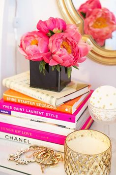 I'm not sure how practical it is to keep flowers on your books, but they're gorgeous!