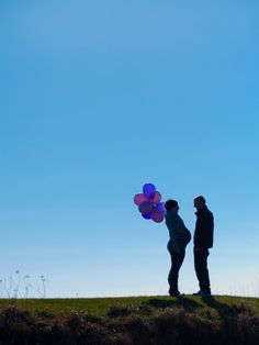 Maine Wedding Photography, unique creative modern romantic, LAD Photography, maternity, mother and father, mom and dad, pregnancy pregnant, on beach on grassy cliff, belly bump, sillhouette, balloons, purple