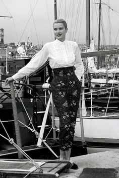 In May 1955, Grace was at the head of the US delegation sent to the Cannes Film Festival. It was at a magazine shoot for Paris Match that she first met Prince Rainier III. Here, aboard a yacht in the marina, Grace posed in a pair of Capri pants – a style that became part of her signature look.