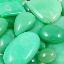 Chrysoprase is a delightful stone of the green ray. It is a variety of chalcedony, which is a type of quartz, and is one of the more valuable stones of this group. It brings through the vibration of Divine Truth... and promotes joy and happiness... while healing the heart of energies of depression and anxiety. It has metaphysical properties for healing as well as being a stone to attract new love and abundance and prosperity.