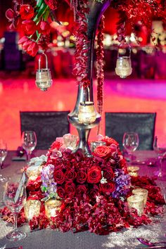 Gorgeous tall red centerpieces with candles - perfect for a dark, romantic wedding
