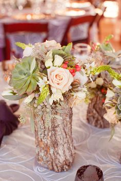rustic log and flora centerpiece