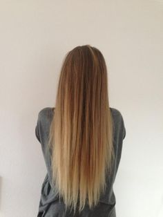Long straight caramel blonde hairstyle with light faded colors...