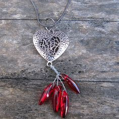 This gorgeous antique silver heart with filigree centre hangs from a nickel-free gunmetal-plated snake chain and features a red-hot acrylic bead fire burst. Acrylic Beads, Indie Brands, Antique Silver, Spring Fashion, Artisan, Jewelry Making, Pendant Necklace, Centre, Antiques
