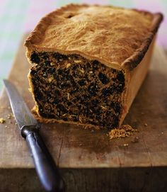 """Scottish black bun - baked for """"first footing"""" -an old Hogmanay custom: shortly after midnight, neighbours would visit one another to offer their best wishes for the New Year and take gifts such as black bun (a fruit cake wrapped in pastry) to symbolise that the household would not go hungry that year. http://www.deliciousmagazine.co.uk/recipes/scottish-black-bun/"""