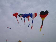 Heart Kites. Order custom kites with a proposal message, go on a picnic with a group of friends and fly them!