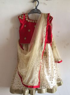 Red raw silk blouse and cream sequin lehenga with gold accents