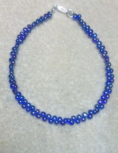 "I created this Anklet using small glass cobalt blue fringe beads 3mm Silver Tone Rounds Silver Tone Lobster Clasp total length 9-1/2"" from end to end I use 49 Strand Professional Beading wire can be s"