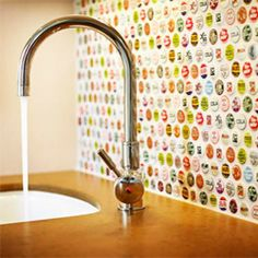 Is this not genius or what? Bottlecap backsplash! We found this one via Apartment Therapy and we are in loveeee.