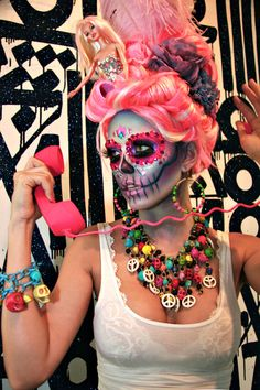 Sugar skull makeup and then some... haha this is a theme i could go nuts with. This is Awesome