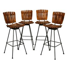 Set of 4 Arthur Umanoff Slat Wood and Wrought Iron Bar Height Swivel Barstools | From a unique collection of antique and modern stools at https://www.1stdibs.com/furniture/seating/stools/