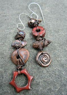 Asymmetrical earrings, love the messy wirework