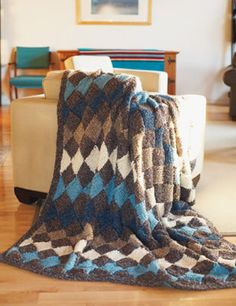 "Entrelac Blanket to Knit, Pattern from Michaels, uses Loops and Threads Country Loom and size 13 36"" needle."