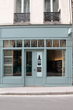 Painted teal shop facade - Aesop (Paris)