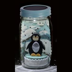 A solar-powered LED in the lid turns on automatically in the dark to magically light up the inside of the jar.  A fun decoration or nightlight for the shelf. Place in a sunny window daily to recharge. Perfect gift for your little penguin.
