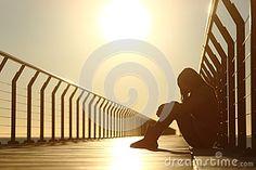 Sad Teenager Girl Depressed Sitting In A Bridge At Sunset Stock Photo - Image: 51068132