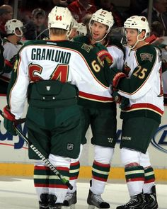 DETROIT, MI - JANUARY 25:  Mikael Granlund #64 of the Minnesota Wild celebrates with teamates Tom Gilbert #77 and Jonas Brodin #25 after a goal during a NHL game against the Detroit Red Wings at Joe Louis Arena on January 25, 2013 in Detroit, Michigan.  (Photo by Dave Reginek/NHLI via Getty Images)