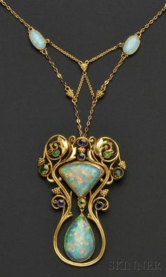 Arts Crafts Opal and Gem-set Pendant Necklace, F.G. Hale, bezel-set with two shaped opal cabochons measuring approx. 25.00 x 16.00 x 5.50 and 23.00x 19.00 x 5.00 mm, further bezel-set with amethyst, sapphire, peridot, green tourmaline, and demantoid garnets, in a foliate mount with grape cluster motifs, suspended from a conforming chain with two bezel-set opal cabochons with black onyx backs, 18kt gold mount with 14kt gold chain, lg. 2 3/4, 16 3/4 in., signed F.G. Hale/ JV