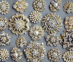 This listing is for 10 pieces of Assorted High Quality Sparkling rhinestone pearl button embellishments. Perfect for your Craft DIY Supplies! Size (approx): range from 1.2 to 2 even larger (28mm to 50mm even larger). Material: metal base with clear rhinestones and/or off-white