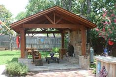 Fort Worth free standing covered patio with outdoor fireplace
