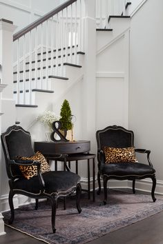 Chic foyer features a pair of black velvet French chairs accented with silver na. Chic foyer features a pair of black velvet French chairs accented with silver nailhead trim lined w French Decor, Leopard Pillows, French Chairs, Foyer Furniture, Traditional Staircase, Entrance Foyer, Vintage Home Decor, Vintage House, Cheap Home Decor