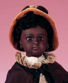 """German Bisque Brown Complexioned Girl,by Bahr""""Bisque cocket head,richbrown complexion,brown glass inset eyes,open mouth,row of porcelain teeth,fleecy wig,Sonneberg composition brown-complexioned body,antique costume.- Theriault's Antique Doll Auctions"""