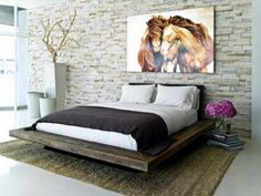 Awesome platform bed from reclaimed wood and awesome art above.