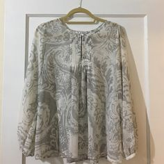 Cabi Print Blouse Cabi Print Blouse. Size Small (may fit medium due to flowing style). Cream and Gray Print. Pleat detail on the top front and back of blouse. 100% Polyester. In good preowned condition. Please feel free to ask any questions or request measurements. Thanks for looking! CAbi Tops Blouses