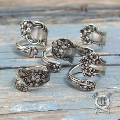 You are looking at a lovely assortment of 5 spoon rings handmade from recycled metal. These rings are easily adjustable. All you have to do is gently