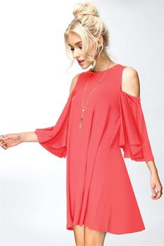 This chic and flirty swing dress features a cold shoulder sleeve, beautiful ruffle sleeves, and an adorable swing fit. Perfect for a date night to dining with f