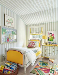 A children's room's chest of drawers was papered to match the ceiling, walls and Roman shade | archdigest.com