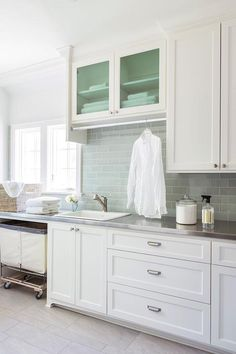 laundry Room with Stainless Steel Countertops, laundry basket