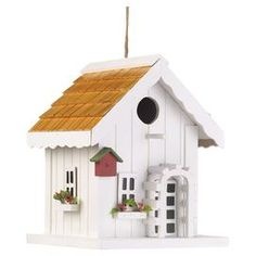 """Invite feathered friends to your yard with this charming bird house, crafted of wood and showcasing a cottage silhouette.  Product: BirdhouseConstruction Material: WoodColor: WhiteFeatures:  Flower boxes under windowsHangingDimensions: 9"""" H x 7.13"""" W x 7.13"""" D"""