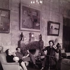 At the Paris home of Marie-Laure de Noailles, Hotel de Bischoffsheim, France. The Vicomtesse is seated left, next to novelist Philip Toynbee, opposite cellist Maurice Gendron. Photo by Cecil Beaton 1938