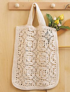Elegant crochet bag features a beautiful lacy motif. The perfect tote for books, shopping, lunch, and everything else. (Yarnspirations)