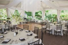 Tent Wedding Venue - love the outdoors feel with the protective tent cover!  very elegant & would love the colors to be plum/wine & cream :)