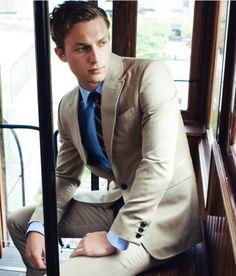 Tan suit and blue dress shirt