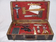Here is some amazing assemblage art of a used 1890s Vampire Hunting Kit. Including crucifix, stake, mallet, hatchet, German stamped letter to the mother of deceased victim, signed new testament bible by hunter Andrew Kauffman along with picture of victim, pliers, Remington derringer pistol, rosary, syringe, garlic extract, sulphur, hair from destroyed vampire, pulled fangs of destroyed vampire & holy oil.